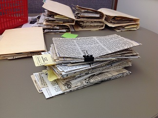 Stack of Newspaper Clippings
