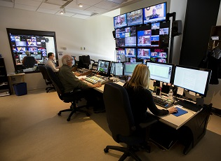 Staff working in House television production room
