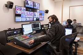 Staff working in Senate television production room